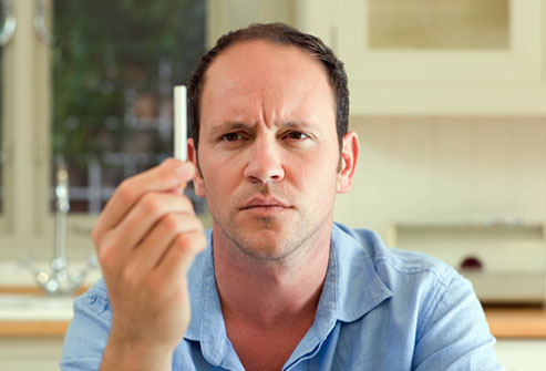 getty_rf_photo_of_balding_man_holding_cigarette